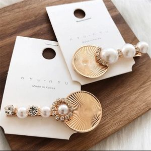 2 Gold metal pearl and rhinestone hair clips